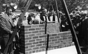 Assistant Bishop and former Vicar, Eric Rich, relays the foundation stone from the 1913 St Matthew's Church.